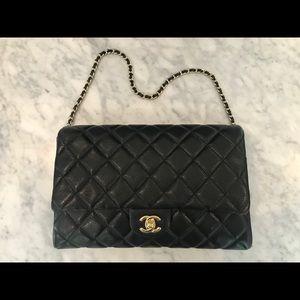 Chanel black caviar clutch on a chain